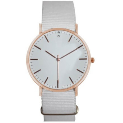 The Nylon Mid Watch is a ladies wrist watch with a alrge round face, hour and minute interval makring, rose gold trim detail and a plain white nylon adjustable wrist strap