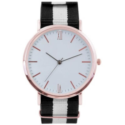 The Nylon Watch is a ladies wrist watch with a large round metal face, rose gold trim and hour interval marking, minute markings and a nylon adjustable black and white wrist strap