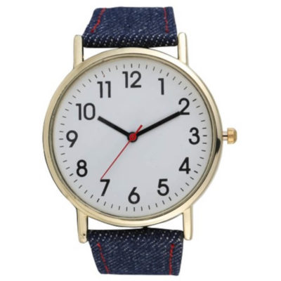The Denim Watch is a unisex wrsit watch with a large metal face, bold numbering, minute and hour interval marking, gold trim detail and a denim adjustable wrist strap