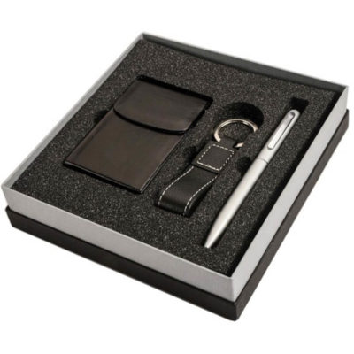 The Card Holder, Key Ring & Pen Gift Set contains a black ascot leather card holder with molded fame and magnetic flap, a leather loop keyring accessory on a metal split ring and a metal twist action silver pen that contains black ink