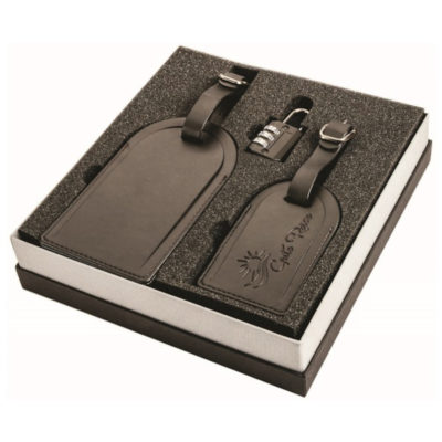 The Luggage Tag Gift Set consists of a small three code combination lock, a small and large synthetic leather luggage tag. In the colour black.