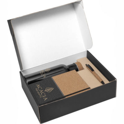 The Scarlett Cork Gift Set contains a cork and thermo PU notebook with a ribbon bookmark, elastic closure and 160 lined pages. A cork barrel ball point pen with a PU clip, tip and trim that contains black German ink. A transparent black Tritan plastic water bottle with a screw on cork lid and a 750ml liquid capacity