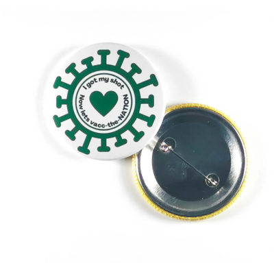The Button Badge is a round metal button badge with a safety pin backing