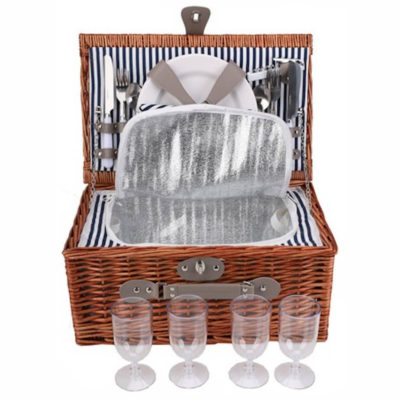 The 4-Person Wicker Picnic Basket is a dark brown wicker basket with a 210D lining and inner cooler compartment. Includes a table setting for four people, the set contains four ceramic plates, four stainless steel cutlery sets, plastic glasses, cotton napkins and a stainless steel bottle opener