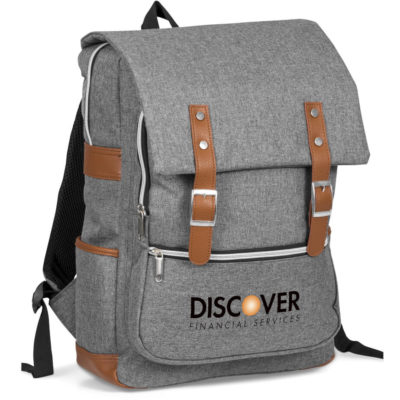 """The Hudson Tech Backpack is a grey 1000D poly canvas fabric backpack with contrasting brown simulated leather detailing. Features three zippered storage compartments, two side pouches, padded and adjustable shoulder straps, padded back panel, a top carry handle and a flap cover with buckle accents and magnetic closure. Can store a 15.6"""" laptop"""