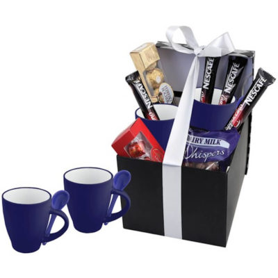 The Mug & Spoon Coffee Hamper has two blue 350ml ceramic mugs with a packet of Whispers, a Ferrero Rocher Box, Lindt Lindor Box and 4 x cappuccino sachets