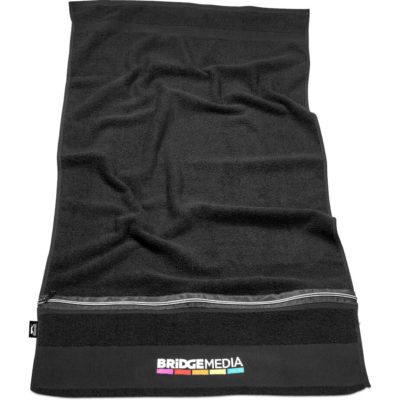 The Slazenger Wembley Gym Towel is made from black 100% cotton with a front zip pocket.