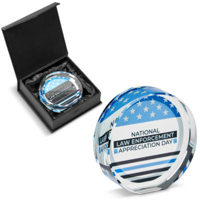 The Mistral Alto Round Mini Award made from optical glass in the shape of a circle and comes inside a black gift box