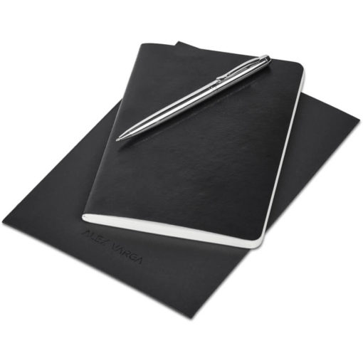 The Alex Varga Small Soft Cover Notebook And Pen Set contains a black soft cover PU notebook eith 104 cream coloured pages with back to back lines, and a black ink aluminium pen with a chrome coating. Packaged in a black paper pouch
