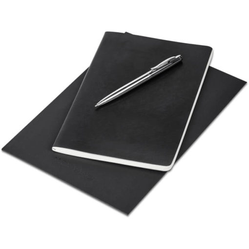 The Alex Varga Medium Soft Cover Notebook And Pen Set contains a black soft cover PU notebook eith 104 cream coloured pages with back to back lines, and a black ink aluminium pen with a chrome coating. Packaged in a black paper pouch