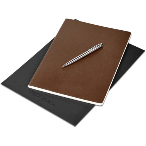 The Alex Varga Large Soft Cover Notebook And Pen Set contains a black soft cover PU notebook eith 104 cream coloured pages with back to back lines, and a black ink aluminium pen with a chrome coating. Packaged in a black paper pouch