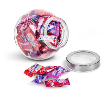 The Mentos Classic Glass Candy Jar contains 50 individually wrapped mixed berry chewy sweets in a transparent glass jar with two flat surfaces to rest on a steel & acrylic screw on lid
