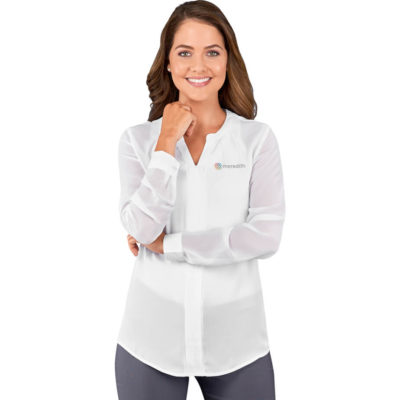 The Ladies Long Sleeve Zenobia Blouse is made from 100g/m² 100% polyester with a double placket down center front, a mandarin collar with two pleats, pleated detail at the cuff with one button and a mandarin collar with two pleats. Available in different sizes.