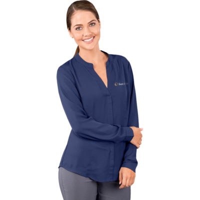 The Ladies Long Sleeve Ava Blouse is a navy 100% polyester long sleeve lightweight blouse. With a mandarin collar, placket down the front centre, bust darts and a keyhole and pleat detail at the cuff with one button