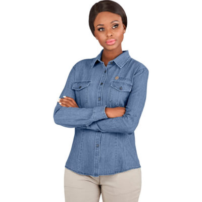 The Ladies Long Sleeve Eastwood Shirt is a denim blue 5.2oz 100% cotton, cross hatch denim long sleeve dress shirt. With two front v-pockets with button down flaps, front darts and a curved hem