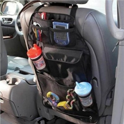 The Hanging Car Seat Organiser is a black motor vehicle accessory made from 300D oxford cltoh fabric. Designed to hang over the back of the driver or passenger seat and has multiple pockets for storage purposes. Includes 1 x Velcro pocket, 2 x mesh pockets, 2 x drink holders and 4 x pen holders