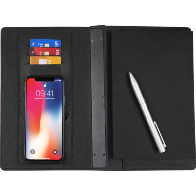 The Notebook With Wireless Powerbank is a black hardcover notebook with lined pages, internal sotrage on the inner flap for cards, a powerbank on the back spine, a wireless charging pad on the inner flap and an elastic band closure