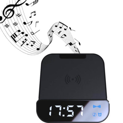 The Wireless Powerbank, Speaker & Alarm Clock is a black plastic desk item with a 4000mAh wireless charging pad, a USB port for cable charging, a 5W Bluetooth speaker, 10m operating distance and10 hours of playtime, with a clear LCD clock display