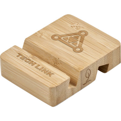 The Okiyo Shinpura Bamboo Phone & Tablet Stand is a bamboo phone or tablet holder with two grooves on either side, designed to hold either a tabler or a mobile device with or without its protective cover on